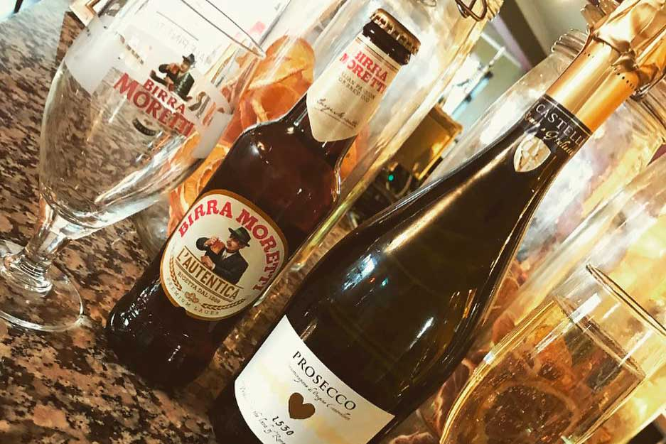 Photograph of a bottle of Prosecco and a bottle of Moretti beer