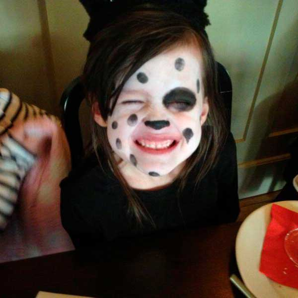 Young child with dalmatian-style face painting